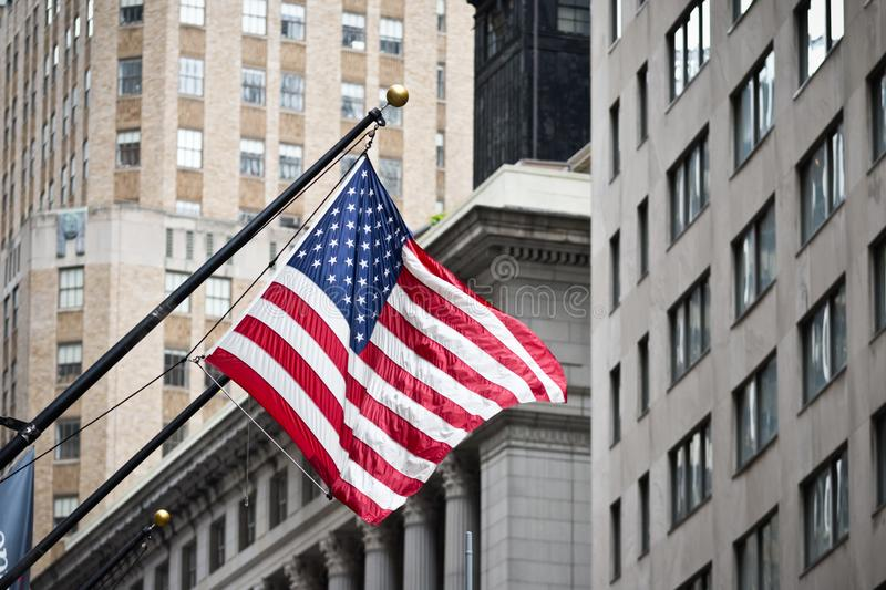 Wall street American flag in the Financial District of Lower Manhattan royalty free stock photography