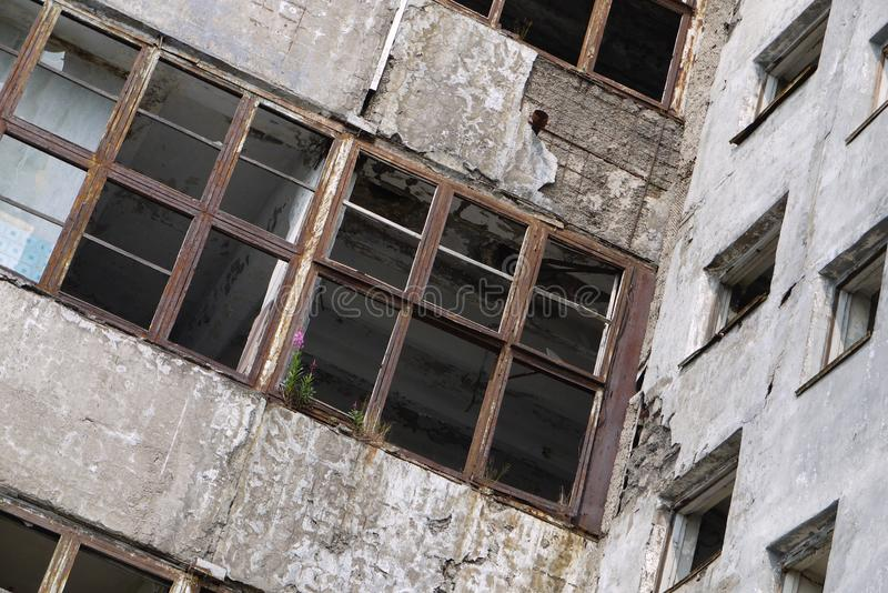 View of the walls and empty windows of an abandoned building royalty free stock photography