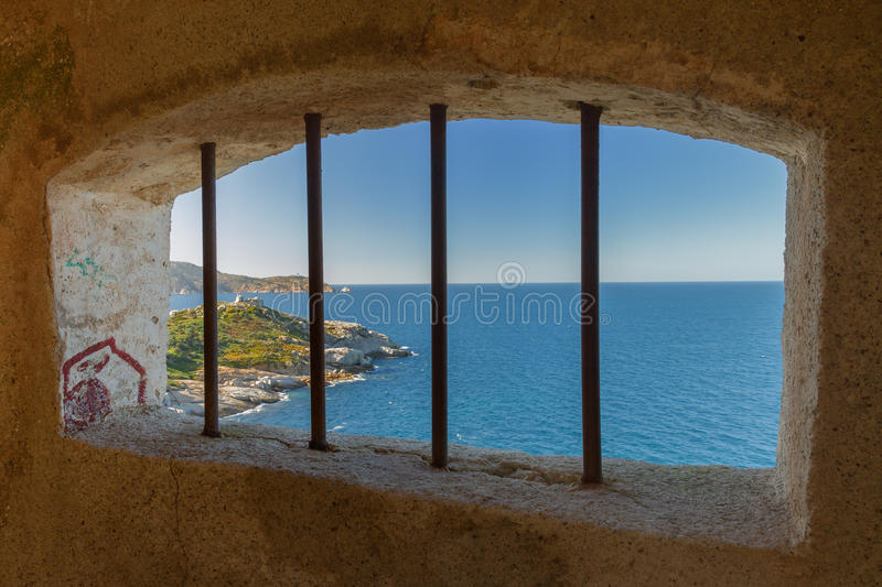 View from a watchtower in the citadel at Calvi, Corsica. Overlooking the Mediterranean, Punta San Francesco and La Revellata lighthouse stock image