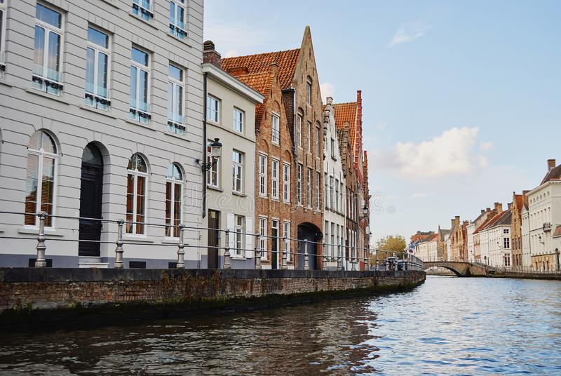 View of water canal and traditional architecture of Bruges royalty free stock photography