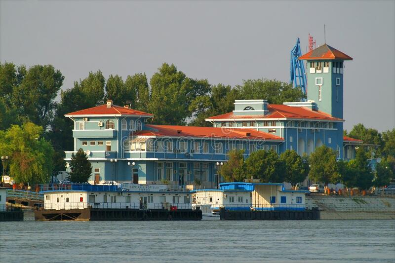 Romanian Naval Authority building on the Danube river side, Giurgiu, Romania. View from the water of Romanian Naval Authority building, Danube river, Giurgiu royalty free stock images