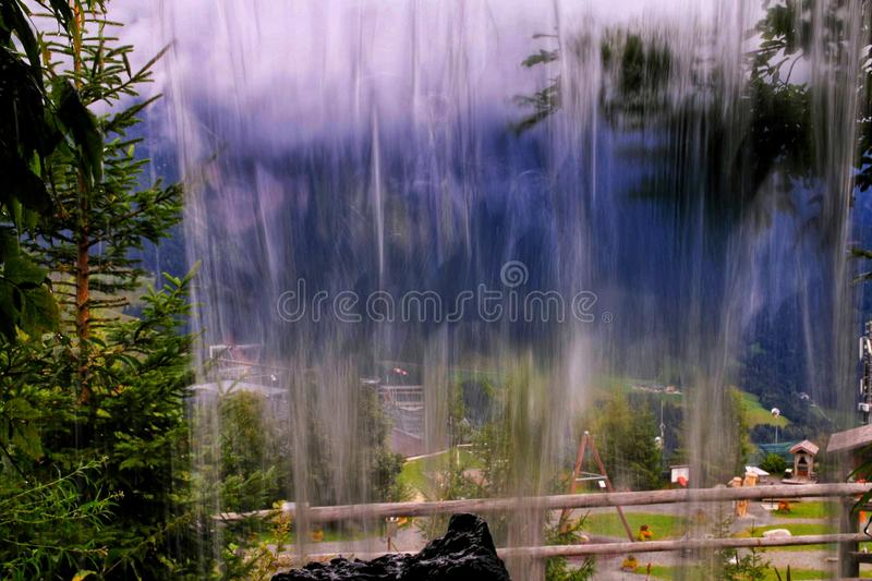 View on a waterfall from the cave behind royalty free stock images