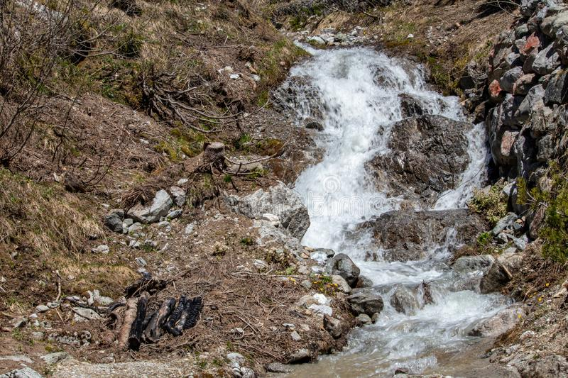 View of waterfalls and mountain streams with a lot of melt water. In spring in the swiss alps stock photography