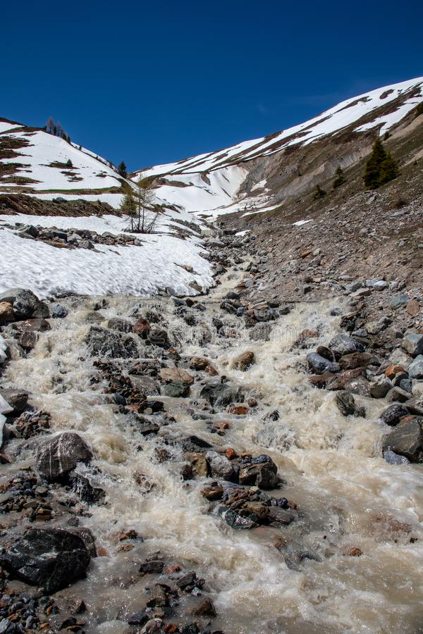 View of waterfalls and mountain streams with a lot of melt water. In spring in the swiss alps stock images