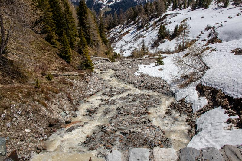View of waterfalls and mountain streams with a lot of melt water. In spring in the swiss alps stock image