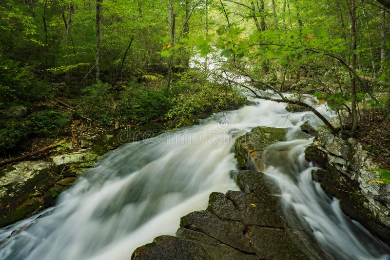 View of Waterfalls at Roaring Run Recreational Area. High water at Roaring Run Waterfall from hurricane Michael located the mountains of the Jefferson National stock photos