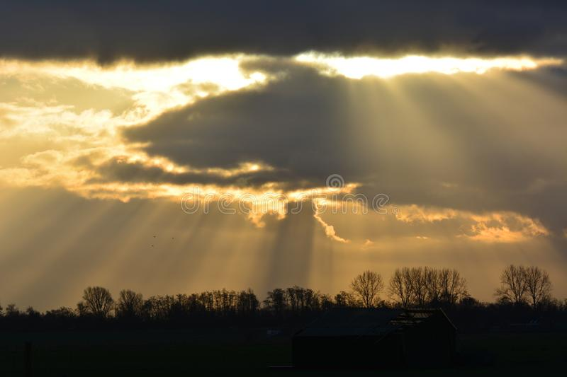 View at Waverveen in the netherlands. On a friday morning in january, the sunbeams coming through the clouds location: Waverveen in the Netherlands stock photo