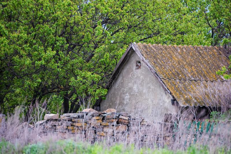 Old abandoned stone house in the countryside stock images