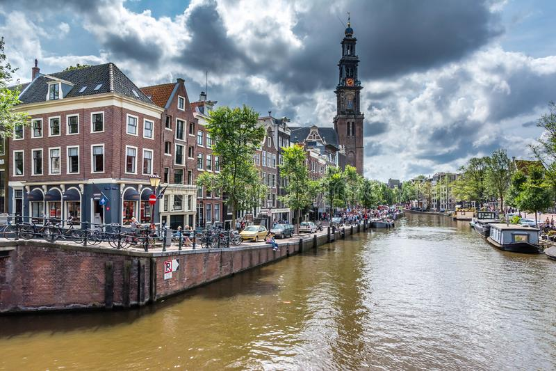 Westerkerk church and Anne Frank house in Amsterdam royalty free stock photography