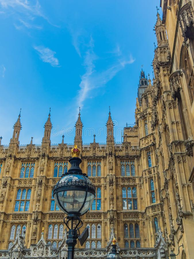View of the Westminster Palace and the Houses of Parliament building facade against the blue sky, London, UK. View of the Westminster Palace and the Houses of royalty free stock photo
