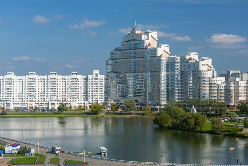 View of white building in Minsk downtown, Nemiga district view with Svisloch river, Belarus. stock photos