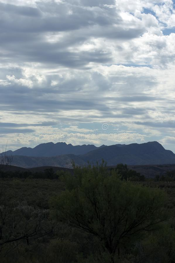 View of Wilpena Pound from Hawker, SA, Australia. Morning view with cloudy sky of Wilpena Pound from Hawker, South Australia, Australia stock photo