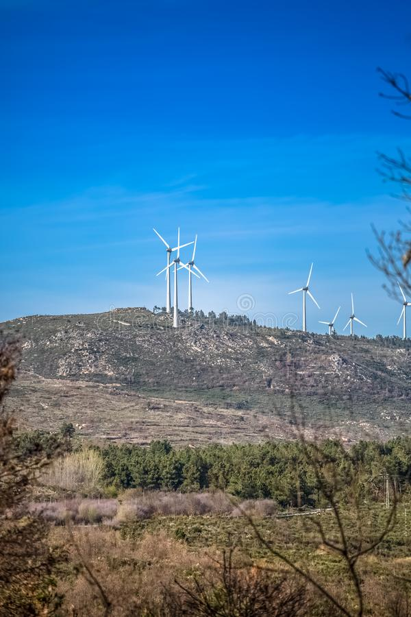 View of a wind turbines on top of mountains royalty free stock images
