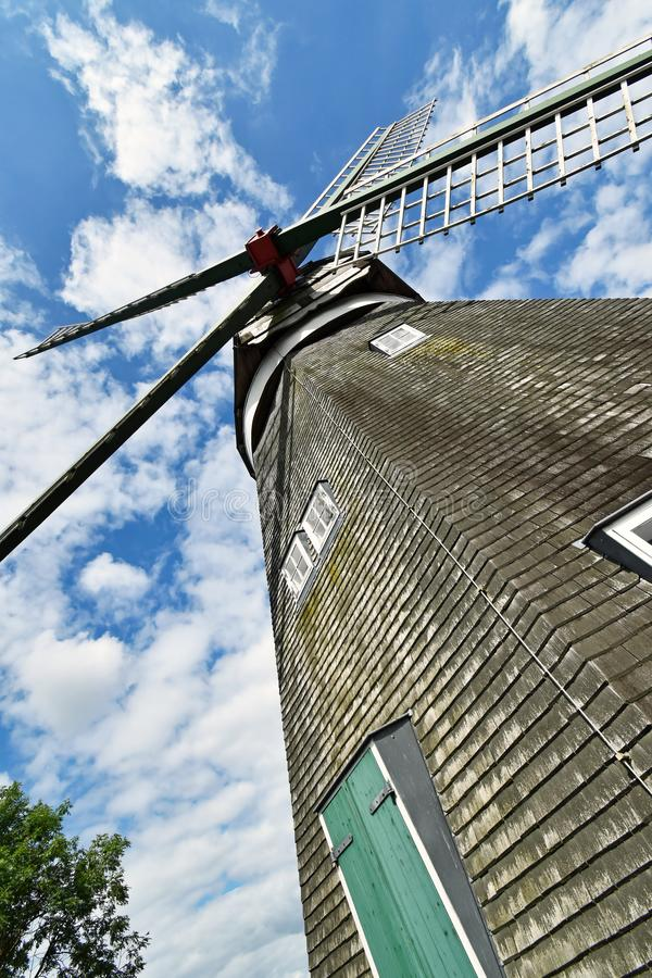 View of a windmill from the bottom up to the wings stock photography