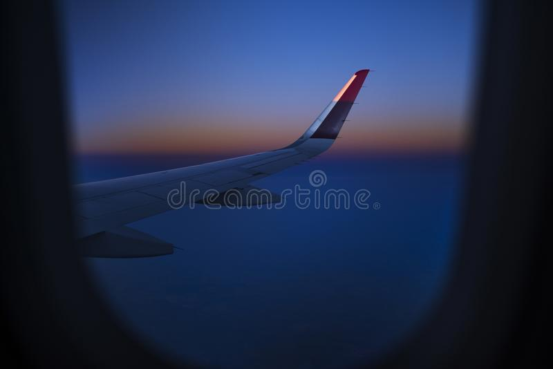 A view from a window in an airplane, wing of an airplane. stock photography
