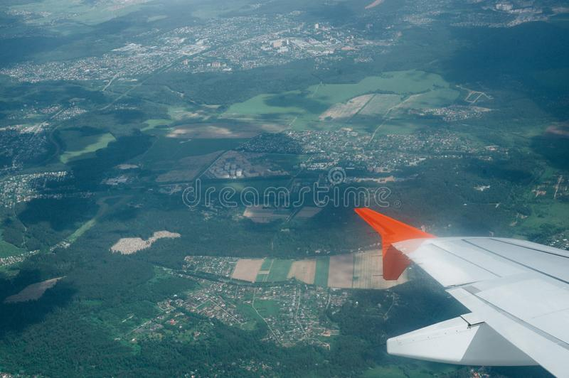 View from window flight on air with flight wing with beautiful blue sky and cloud. Beautiful scenic city view of sunset through the aircraft window. Image save royalty free stock photo