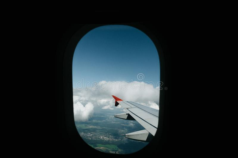 View from window flight on air with flight wing with beautiful blue sky and cloud. Beautiful scenic city view of sunset through the aircraft window. Image save royalty free stock photos