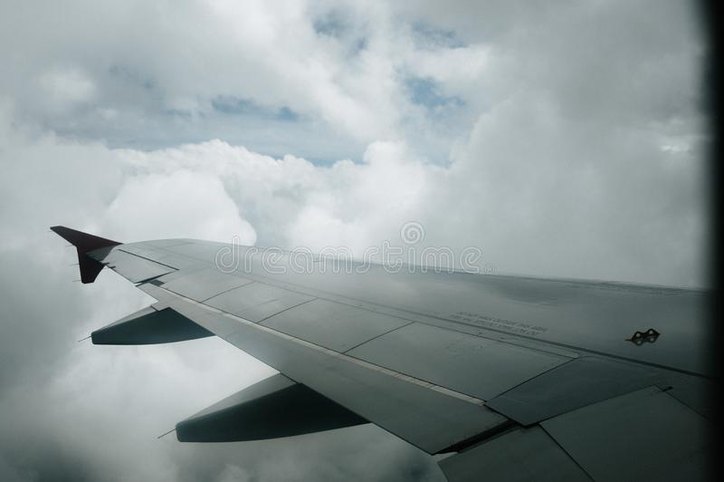 View from window flight on air with flight wing with beautiful blue sky and cloud. Beautiful scenic city view of sunset through the aircraft window. Image save royalty free stock image
