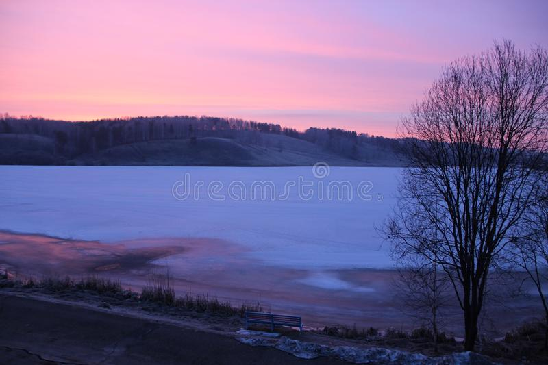 View from the window on ice covered lake stock image