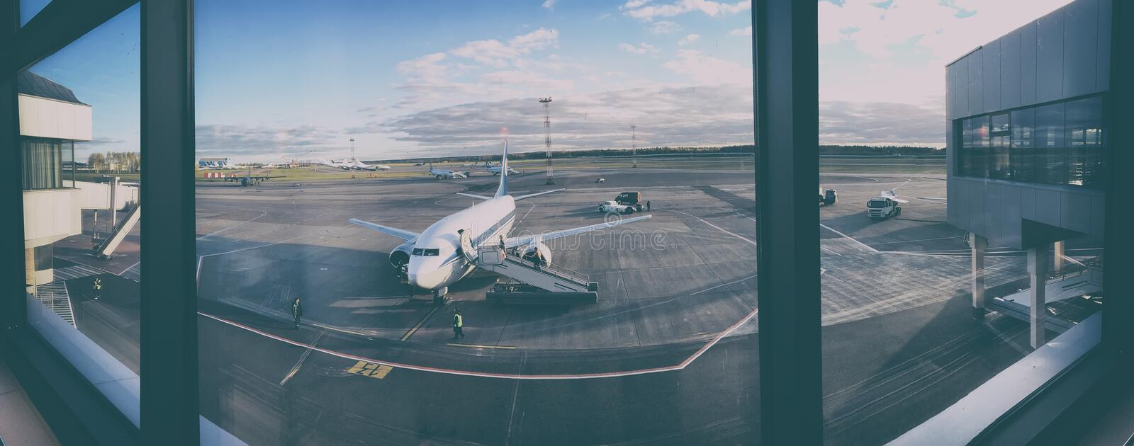 Plane at the airport royalty free stock photo