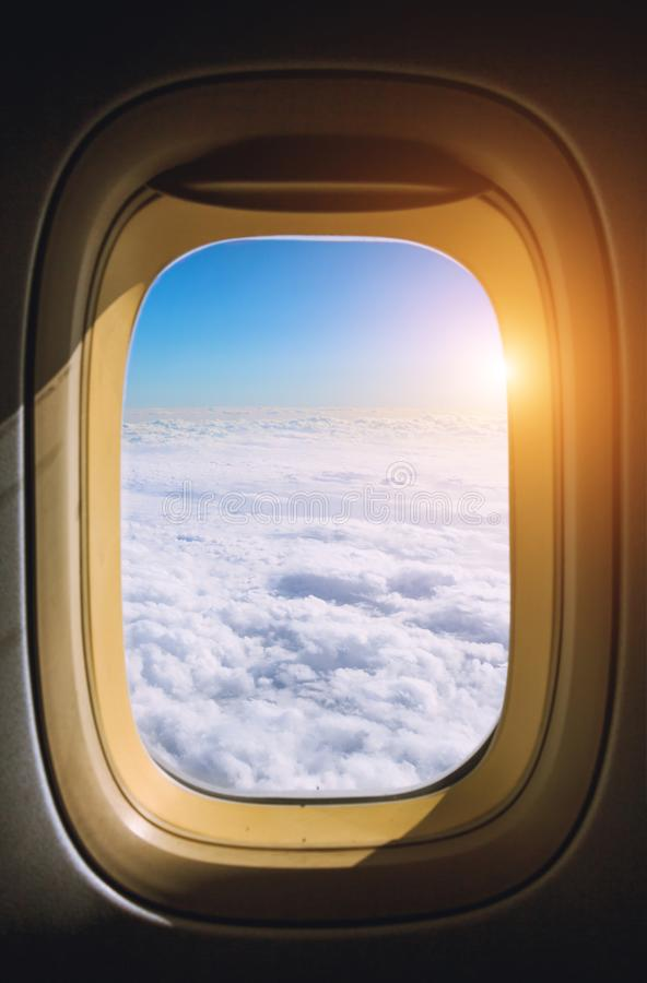 View from the window plane on amazing sky with scenic clouds at the sunset. stock photo