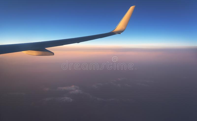 View from the window of the plane to the horizon of the lake and the river in the mountains with forests at sunset of the day royalty free stock photo