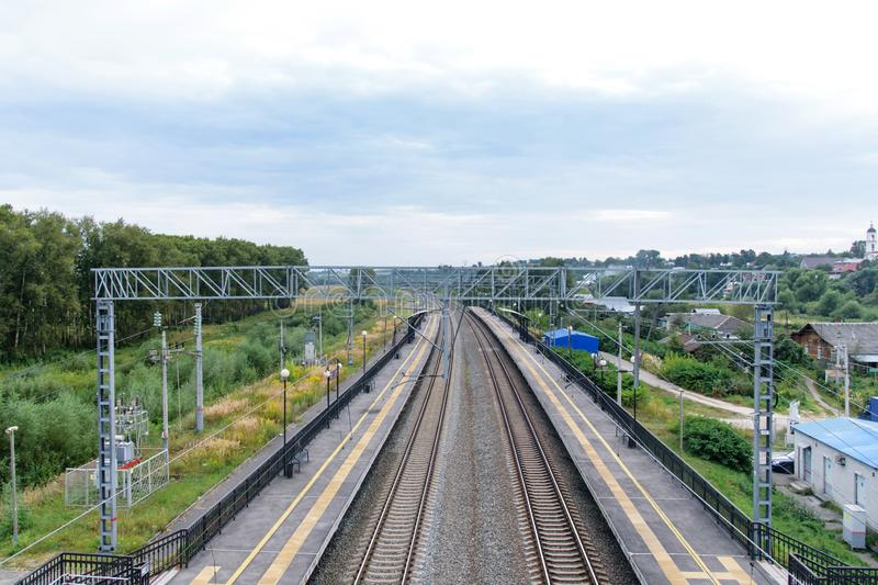 A view from a window of View from the railway bridge to the empty railwaya moving train shot on a wide-angle lens stock images