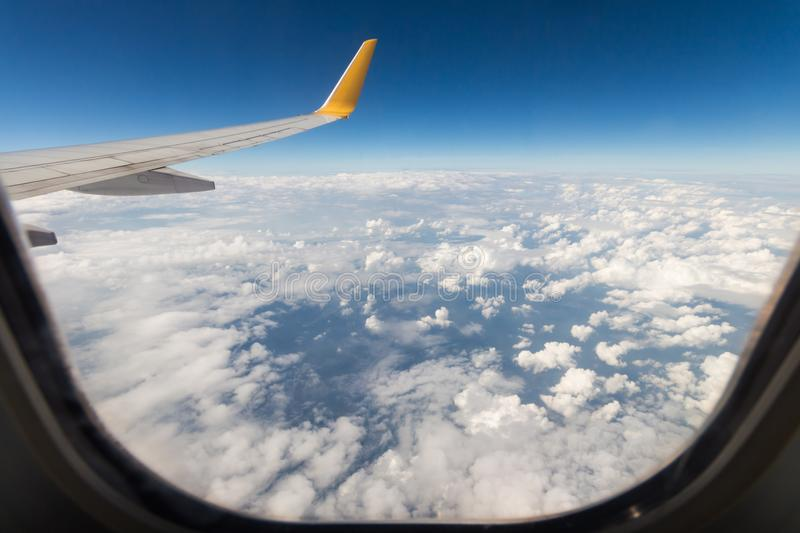 View from a window seat in cabin of the aircraft. royalty free stock photography