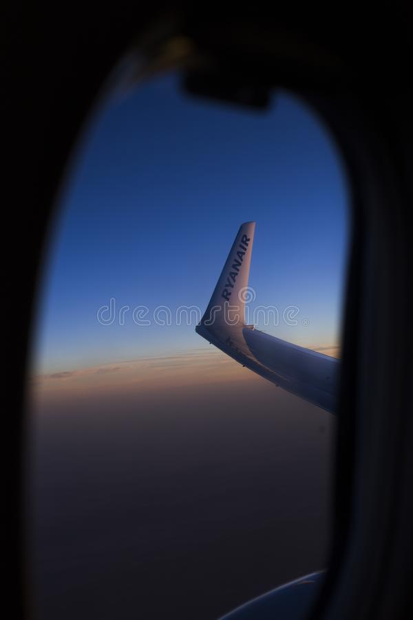 View from window seat during flight. Blue sky at sunrise. Wing. Airplane. Travel concept stock photos