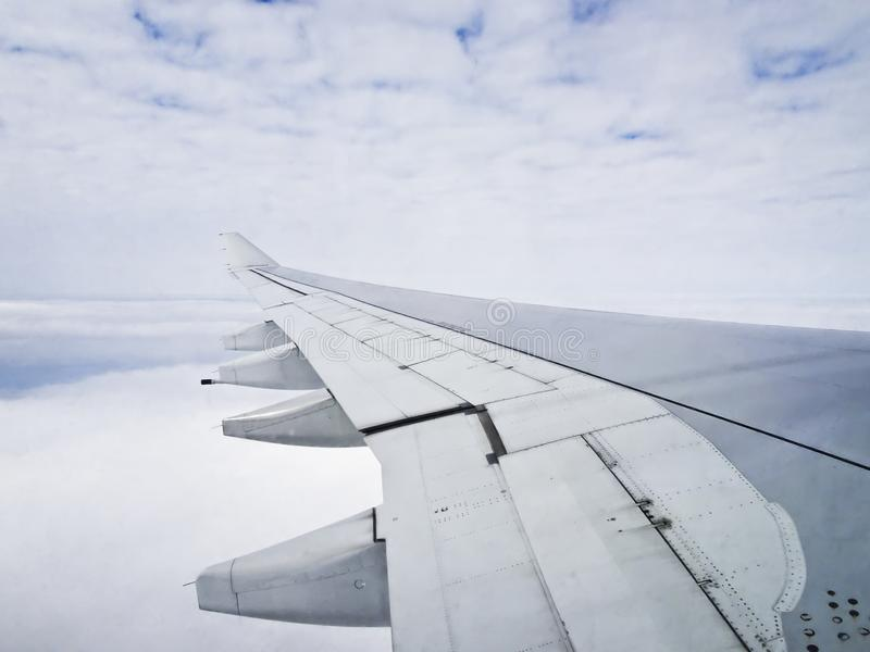 View from the window of a transatlantic airliner - the wing of an airplane stock photos