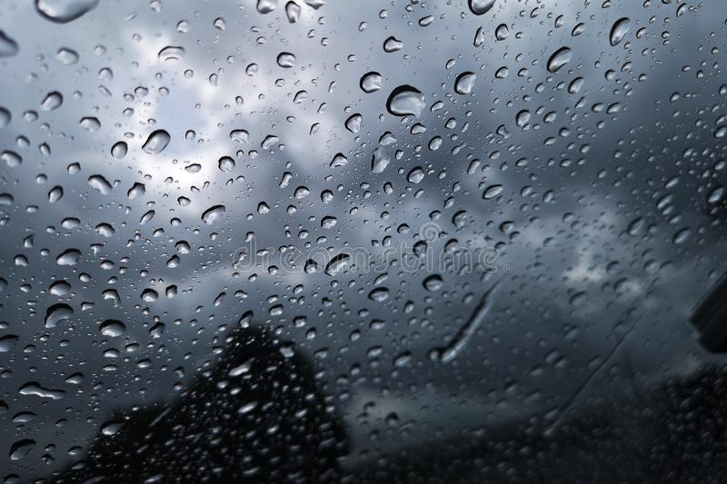 View through the windshield on a rainy night. stock photos
