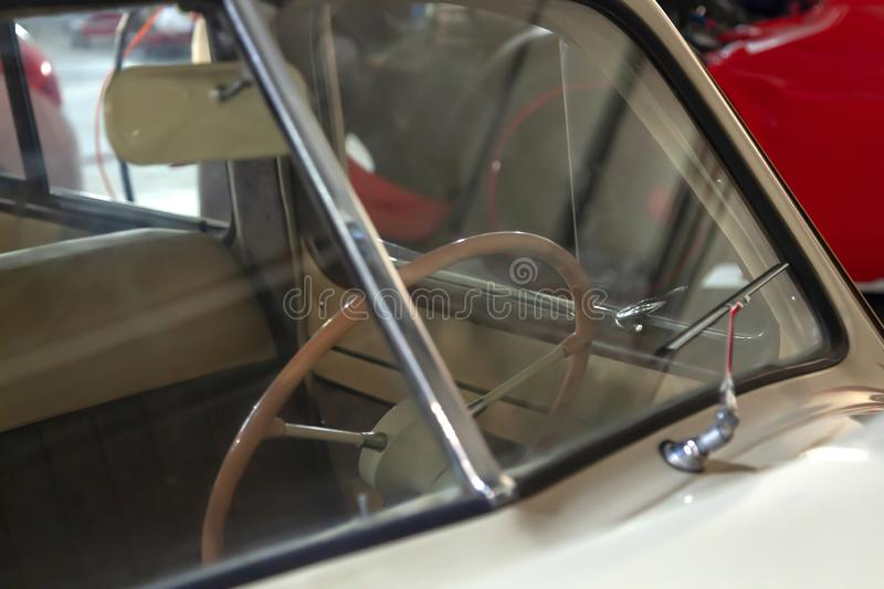 View on Windshield through which you can see the steering wheel and the interior of the old Russian retro vintage car of the stock photos
