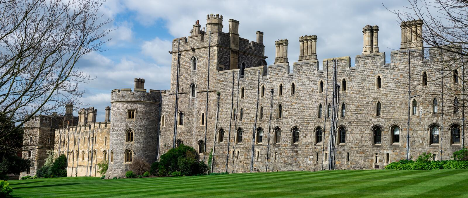 View of Windsor Castle walls and tower with arched windows, England stock photography