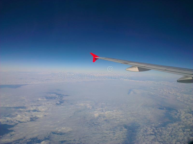 Aircraft Wing and the sky above the clouds. stock images