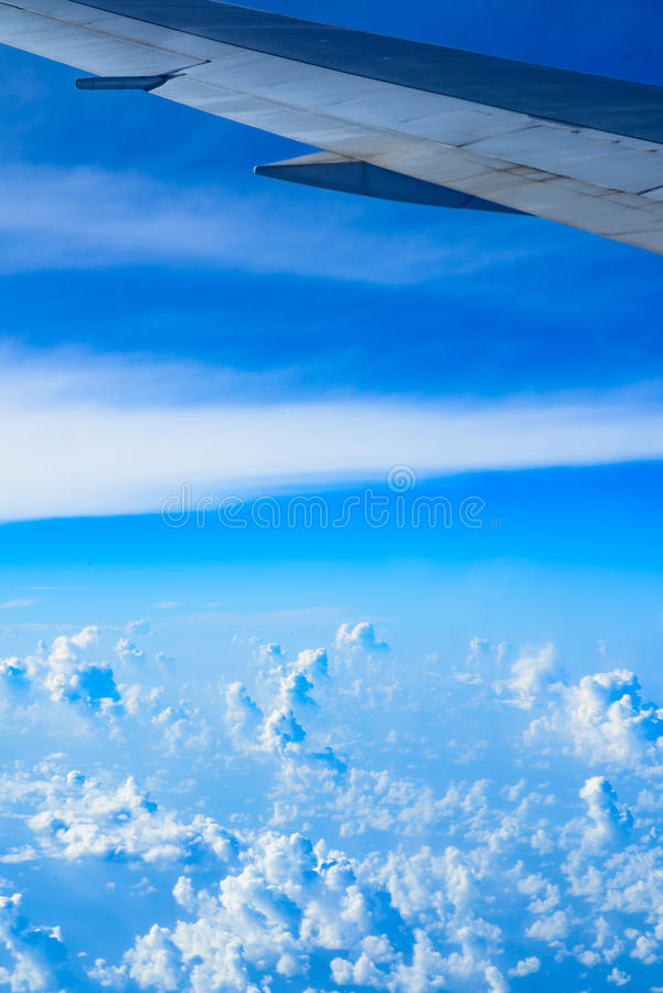View of the wing of an airplane through the window. View of planet earth from an airplane through the window stock photography