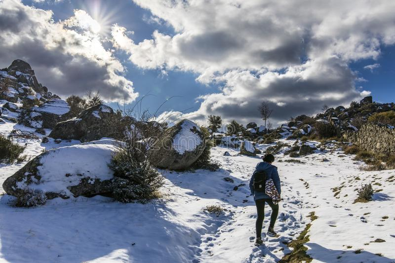 The winter comes and the snow covers the slopes of the `Herreria` forest at El Escorial, Madrid, Spain stock photo