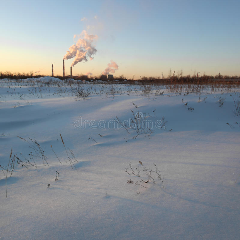 View of a winter industrial landscape. Sunset royalty free stock images