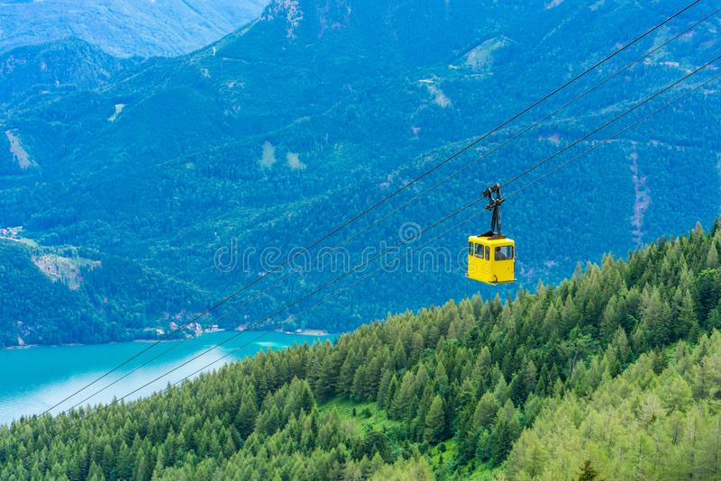 View of Wolfgangsee lake, mountains and yellow Seilbahn cable car gondola from Zwolferhorn mountain. View of  Wolfgangsee lake, surrounding mountains and yellow royalty free stock photos