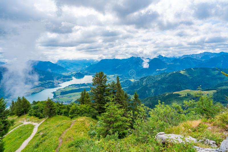 View of Wolfgangsee lake and surrounding mountains from Zwolferhorn mountain in St.Gilgen. Village in Salzkammergut region, Austria royalty free stock photo