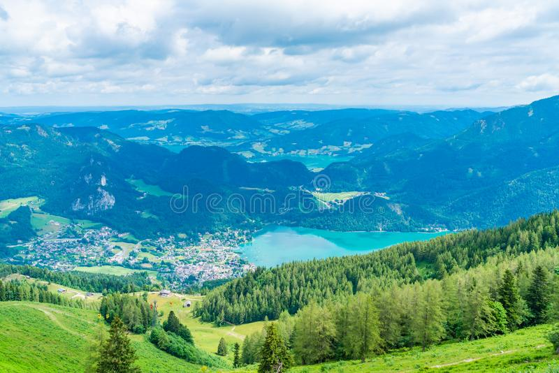 View of Wolfgangsee lake from Zwolferhorn mountain. View of St.Gilgen village, Wolfgangsee lake and surrounding mountains from Zwolferhorn mountain in royalty free stock photography