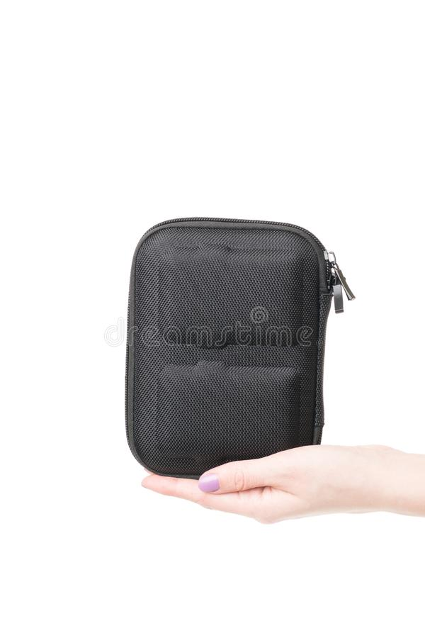 View on the woman palm holding black case for batteries for quadcopter. View on the woman palm holding black carrying hard case for Lipo batteries for quadcopter royalty free stock image