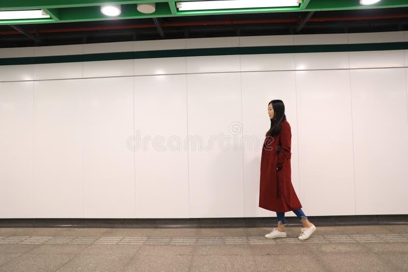 Woman walking alone at night. View of woman walking alone at night stock photos