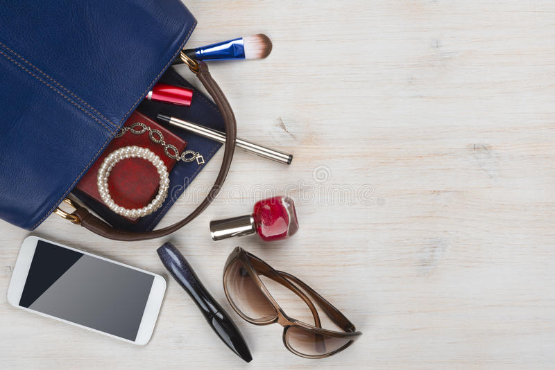 View on women bag stuff with copyspace on wooden background stock image