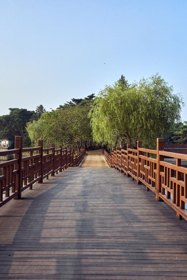 View of wooden bridge and a dirt path at the Uirimji Reservoir in Jechun, South Korea stock photography