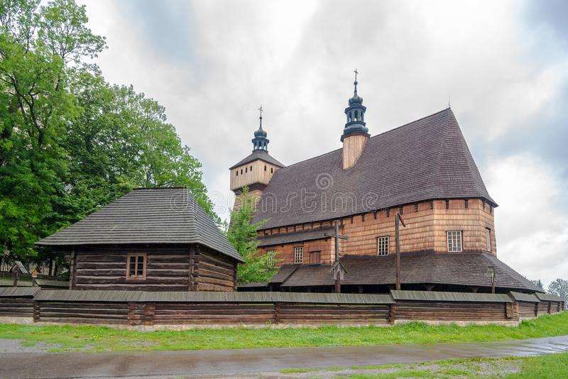 View at the Wooden Church of Assumption of Holy Mary and Saint Michael Archangel from 14th century in Haczow village - Poland royalty free stock photography