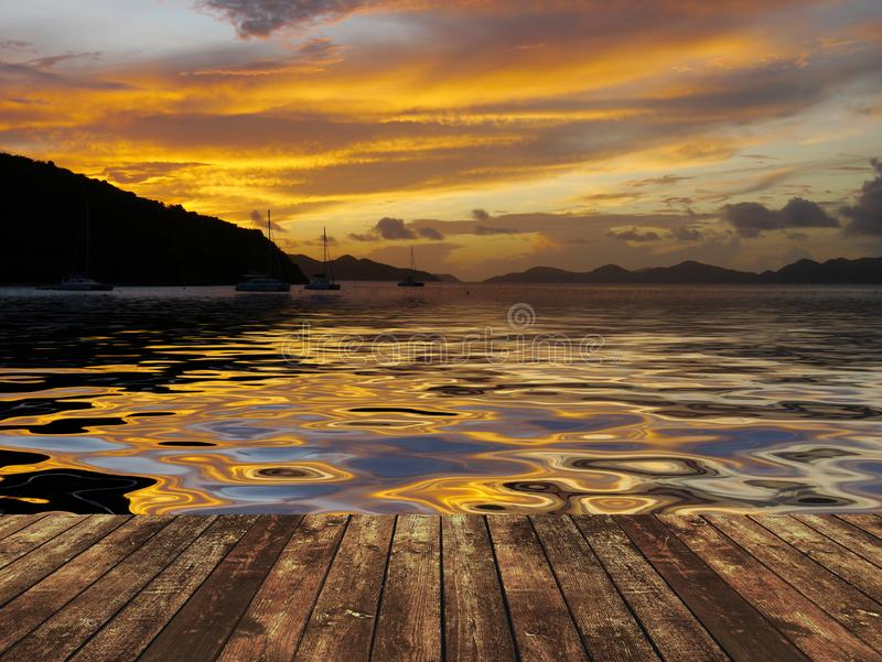 Wooden dock at sunset. A view of a wooden dock at sunset stock photography