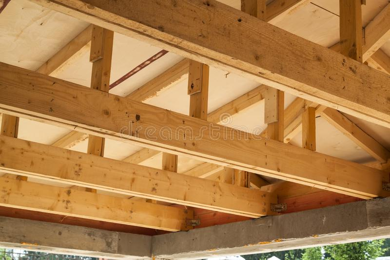 view of wooden rafters when installing roof on construction of house stock photography