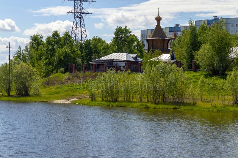 View of the wooden `Temple in the Name of All Saints in the Land of Siberian Shed` from the university royalty free stock photography