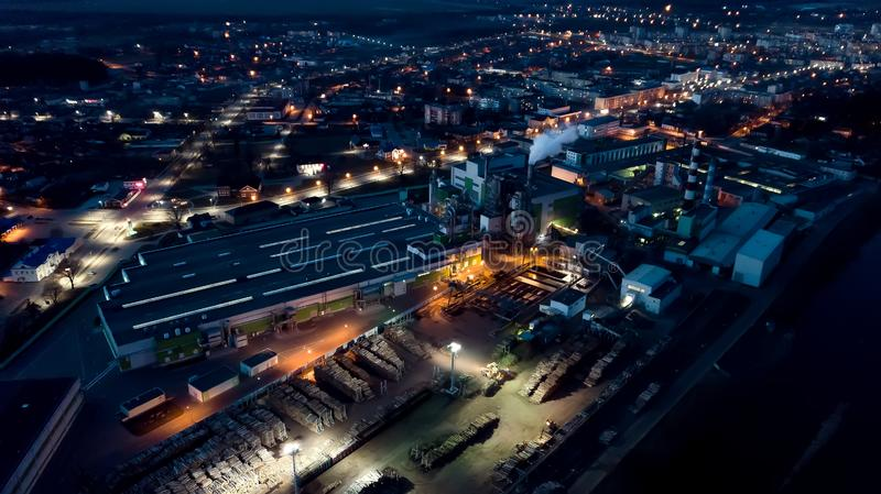 View of the woodworking factory at night. Aerial survey stock photography