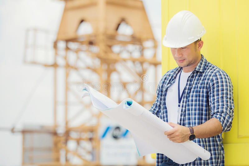 View of a Worker and architect watching some details on a construction stock images